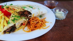 Traditional middle eastern food, shawarma with garnish. Picture of traditional Eastern warm sandwich with garnish. Oriental cuisine, shawarma, kebab stock footage