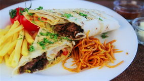 Traditional middle eastern food, shawarma with garnish. Picture of traditional Eastern warm sandwich with garnish. Oriental cuisine, shawarma, kebab stock video footage