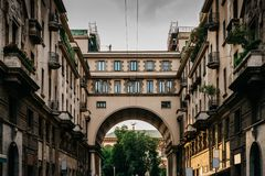 Traditional Milanese buildings with an impressive arch on Via Tommaso Salvini in Milan`s Porta Venezia district, Lombardy, Italy royalty free stock photo