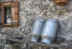 Traditional milk cans from the alps Royalty Free Stock Images