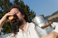 Traditional milk farmer drinking in the nature Royalty Free Stock Photo