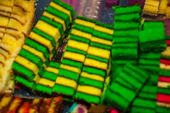 Traditional mixed colors sweet sponge cake. An unusual and Delicious dessert. Borneo, Sarawak, Malaysia. Traditional mixed colors sweet sponge cake. An unusual Stock Image