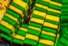 Traditional mixed colors sweet sponge cake. An unusual and Delicious dessert. Borneo, Sarawak, Malaysia. Traditional mixed colors sweet sponge cake. An unusual Stock Photo