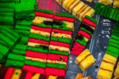 Traditional mixed colors sweet sponge cake. An unusual and Delicious dessert. Borneo, Sarawak, Malaysia. Traditional mixed colors sweet sponge cake. An unusual Stock Photos