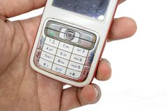 Traditional mobile phone in second generation with keyboard button and mini black and white monitor by white isolate die cut backg. Traditional cellphone during royalty free stock photos