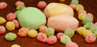 Traditional mochi rice cakes on brown wooden table with colorful Stock Image