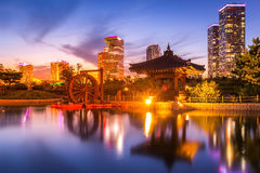 Traditional and modern architecture of Korea. Traditional and modern architecture of seoul city after sunset, central park in songdo International business Royalty Free Stock Photos