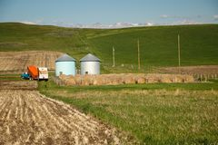 Traditional modern farming in North America, Canada. Typical farm in cowboy country on the south of Alberta stock photography