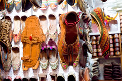 Traditional mojari shoes of varied designs. Traditional mojari shoes (Juttis) of various designs on display. These are shoes made from leather and decorated with Stock Photo