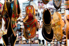 Traditional mojari shoes of varied designs. Traditional mojari shoes (Juttis) of various designs on display. These are shoes made from leather and decorated with Stock Image