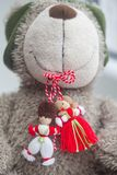 Traditional Moldavien spring symbol Martisor in a toy dog`s teeth. Stock Photography