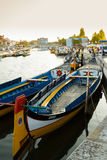 Traditional moliceiro boats in the canal of Aveiro city, in Port. View the traditional moliceiro boats stopped in  the central canal of Aveiro city, in Portugal Stock Images
