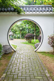 Traditional moon gate in Chinese garden Stock Image