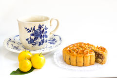 Traditional mooncake with  mix five nuts filling and tea cup Stock Photo