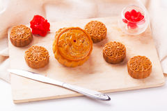 Traditional mooncake on table setting. Royalty Free Stock Photos