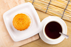 Traditional mooncakes on table setting with teacup. Royalty Free Stock Photography