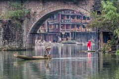 Traditional morning activity in Fenghuang. Traditional morning activity in Tuo river - Fenghuang, China - 10/07/2018 stock images