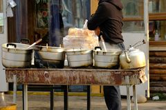 Traditional morning street food in China, using coal fire for heating soup. Perfect breakfast in winter stock photography