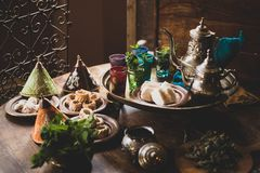 Traditional Moroccan cookies and mint tea royalty free stock photos