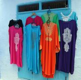 Traditional Moroccan Dresses For Sale. Traditional Moroccan Dresses in different colors with Hamsa symbol design, which is popular in North Africa and The Middle stock images