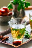 Traditional moroccan mint tea with dates on a vintage tray. Whit. E stone background. Close up Royalty Free Stock Image