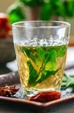 Traditional moroccan mint tea with dates on a vintage tray. Whit. E stone background. Close up Stock Photo