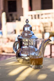 Traditional Moroccan mint tea in a glass. Traditional Moroccan mint tea - Typical Moroccan hospitality Royalty Free Stock Photo