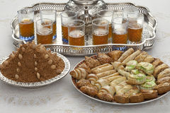 Traditional Moroccan tea at id-al-fitr the end of. Traditional Moroccan tea,cookies and almond sellou at id-al-fitr the end of Ramadan Royalty Free Stock Photos