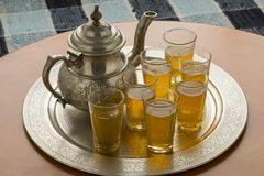 Traditional Moroccan tray with teapot and tea glasses stock photo