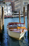 Traditional motorboat taxi moored in marina in Venice Stock Image