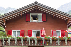 Traditional mountain chalet at Urnerboden on the Swiss alps. Urnerboden, Switzerland - 3 August 2017: Traditional mountain chalet at Urnerboden on the Swiss alps Royalty Free Stock Images