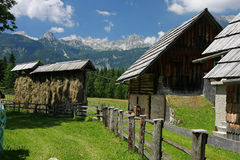 Traditional mountain house in Uskovnica. Traditional mountain house and hay to dry in Uskovnica. Triglav National Park, Slovenia Royalty Free Stock Photography