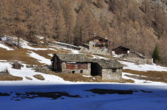 Traditional mountain huts, Italian Alps, Aosta Valley. Royalty Free Stock Photos