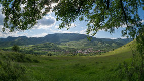 Traditional mountain village at the base of the hill in Romania Royalty Free Stock Photography