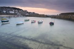 Traditional Mousehole Harbour landscape before sunrise on Cornwa. Mousehole Harbour landscape before sunrise on Cornwall coast in England Royalty Free Stock Images