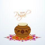 Traditional mud pot with rice on colorful rangoli for Happy Pongal celebrations. Royalty Free Stock Photo