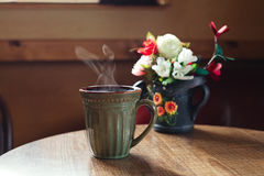 Traditional mug of cofee on wooden cafe table Royalty Free Stock Photos