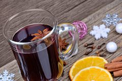 Traditional mulled wine with christmas decoration. On table Stock Photography