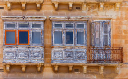 Malta. Traditional balconies on the houses. Traditional multi-colored wooden balconies on the houses. Valletta. Malta Royalty Free Stock Photos