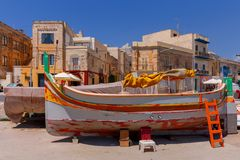 Malta. Marsaxlokk. Traditional fishing boats. Traditional multicolored fishing boats Luzzi in the harbor Marsaxlokk. Malta Royalty Free Stock Photo