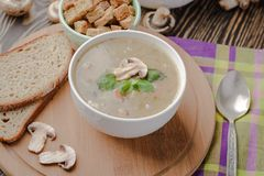Traditional mushroom soup on a wooden background stock photos
