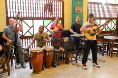 Traditional music band playing for tourists in a restaurant. Havana, Cuba - 27 January 2016: Traditional music band playing for tourists in a restaurant of Old Stock Photography