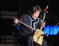 Traditional music of Mongolia. Shanghai - August 7: Artist performs on stage during Inner Mongolia Guangdian Arts Ensemble Concert at Shanghai World Expo 2010 on Royalty Free Stock Photography
