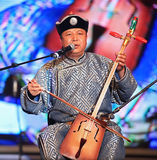 Traditional music of Mongolia, Ode to Khoomii. Shanghai - August 7: Artist performs on stage during Inner Mongolia Guangdian Arts Ensemble Concert at Shanghai Stock Image