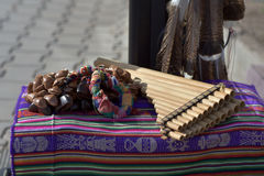 Traditional musical instruments of North American Indians. Lying on a mat Stock Image