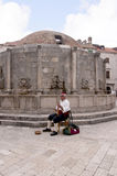Traditional Musician by Onofrono Fountain in Dubrovnic in Croatia Europe Royalty Free Stock Photography