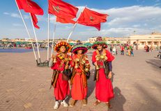 Traditional musicians in colorful clothes. Marrakech, Morocco – April 29, 2019: Traditional musicians in colorful clothes at Jamaa el Fna square royalty free stock images