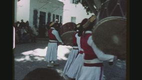 Traditional Musicians Performing. TUNISIA, HAMMAMET REGION, WINTER 1973. Two Shot Sequence Of A Traditional Music Band Performing And Dancing In A Village Square stock video