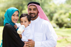 Traditional muslim family. Portrait of traditional muslim family outdoors Royalty Free Stock Photo