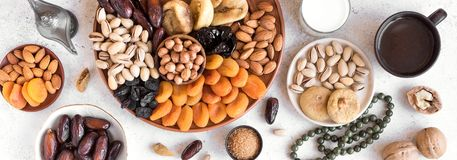 Traditional Iftar Food. Traditional Muslim Iftar Food, copy space. Ramadan kareem with premium dates,nuts, dried fruits, coffee and milk, banner royalty free stock photos
